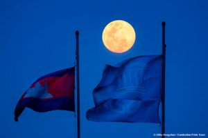 Moonrise blue hour at Preah Vihear Temple above Cambodia flag, UNESCO flag, and World Heritage Site Icon flag