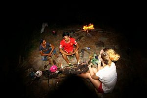 Sharing experiences after dinner during jungle trek