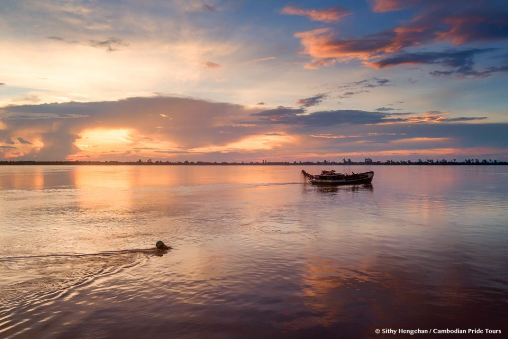 Sand collecting boat in the Mekong during sunset in Kratie