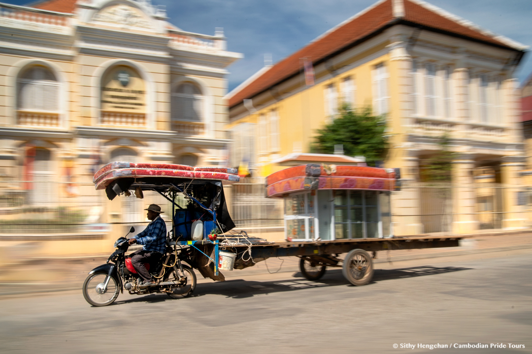 Street Photography in front of French colonial style ancient houses Battambang