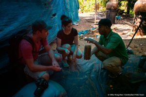 Cambodian Pride Tours guide explaining his guests about mushroom produce