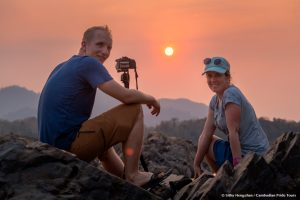 Couple viewing sunset rock and mountrain