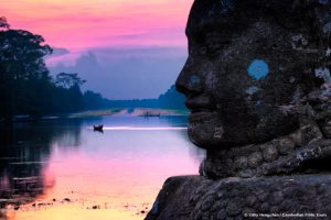 Sunse South Gate Angkor Thom with Giant face of God