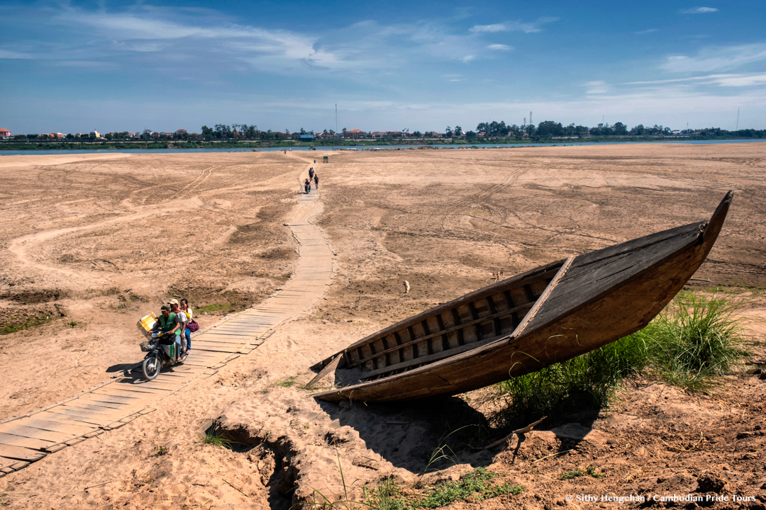 Wooden Path and Broken boat on Koh Trong sandy beach